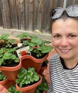 alison with 3 tiwer strawberry planter